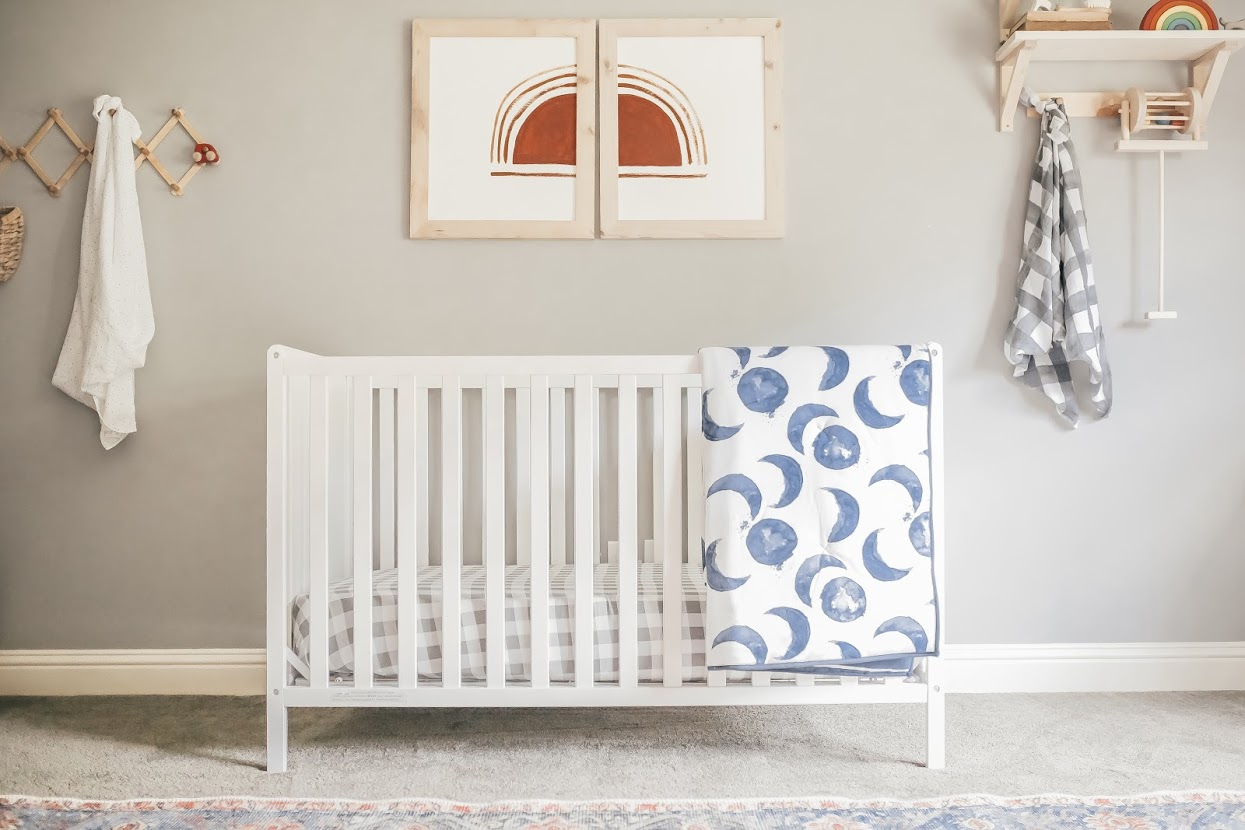 Baby crib with neutral decor.