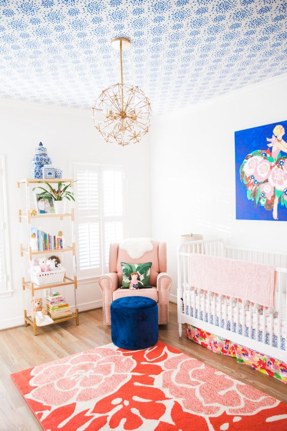 Nursery with colored ceiling.