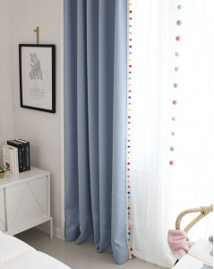 Curtains among nursery decor.
