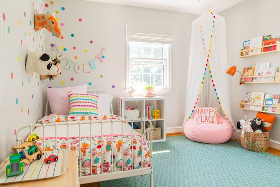 Small kid's bedroom design with colorful polka dots and a canopy over a beanbag.