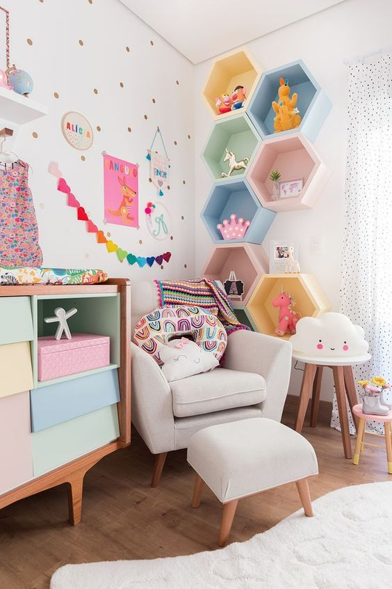 Colorful child's room with colorful hexagonal wall cubbies.