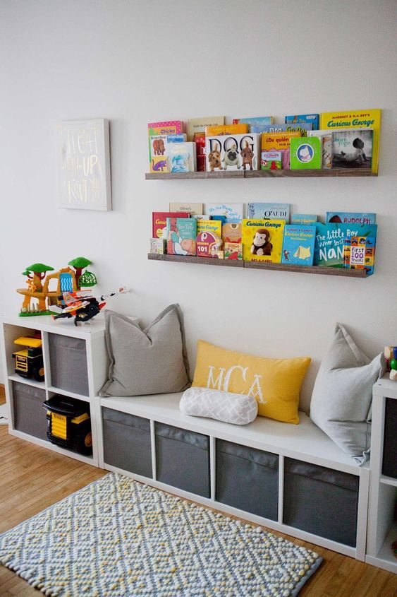 Storage shelves with children's books and a bench with cubbies.