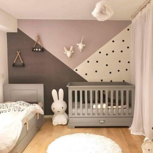 Children's room with alternating colored walls.
