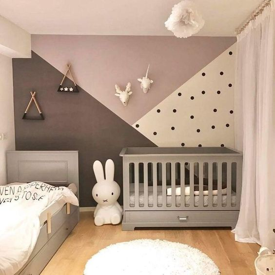 A nursery with a patterned wall