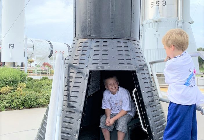 Brothers take turns exploring The Rocket Garden.